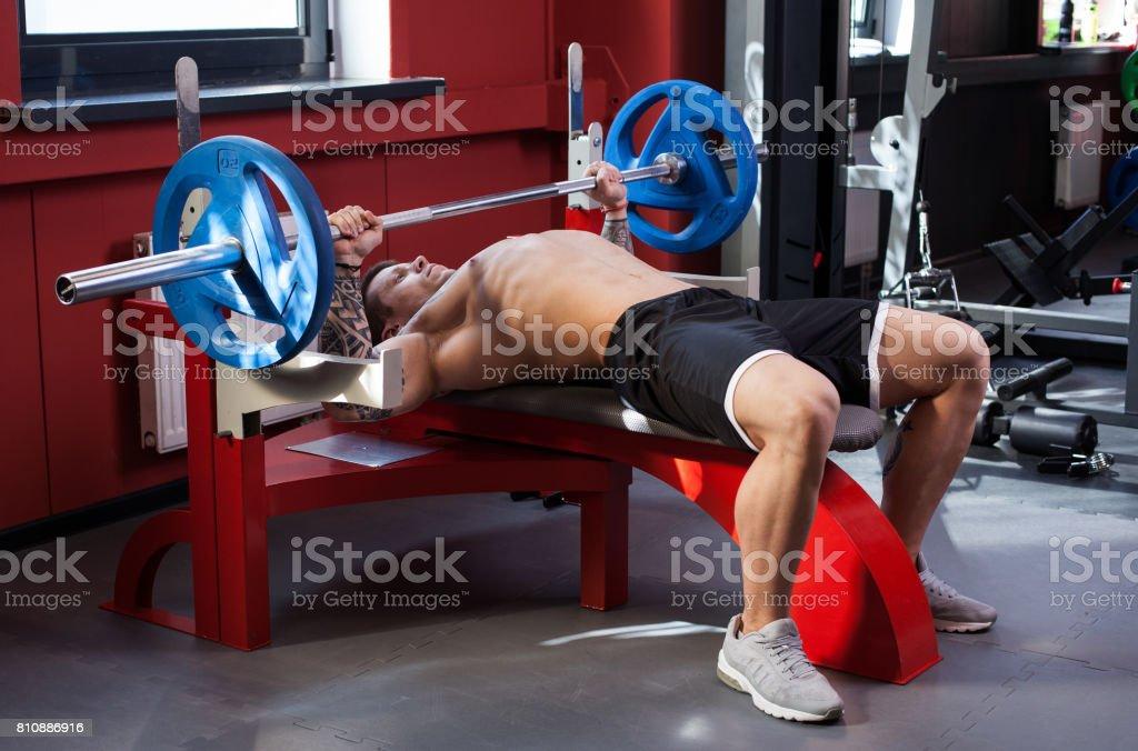 Bodybuilder man performing bench press stock photo