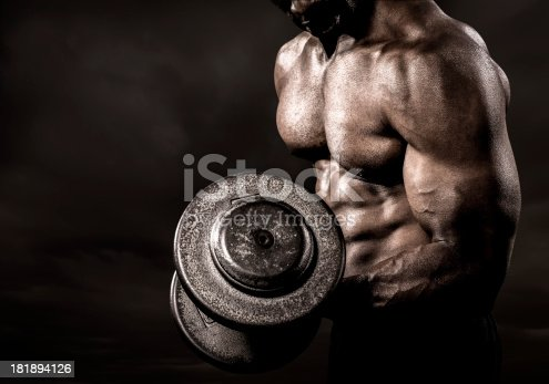istock Bodybuilder performing power lift curl 181894126