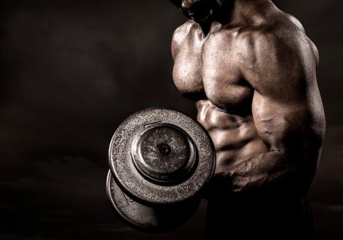 istock Bodybuilder performing power lift curl 181894126