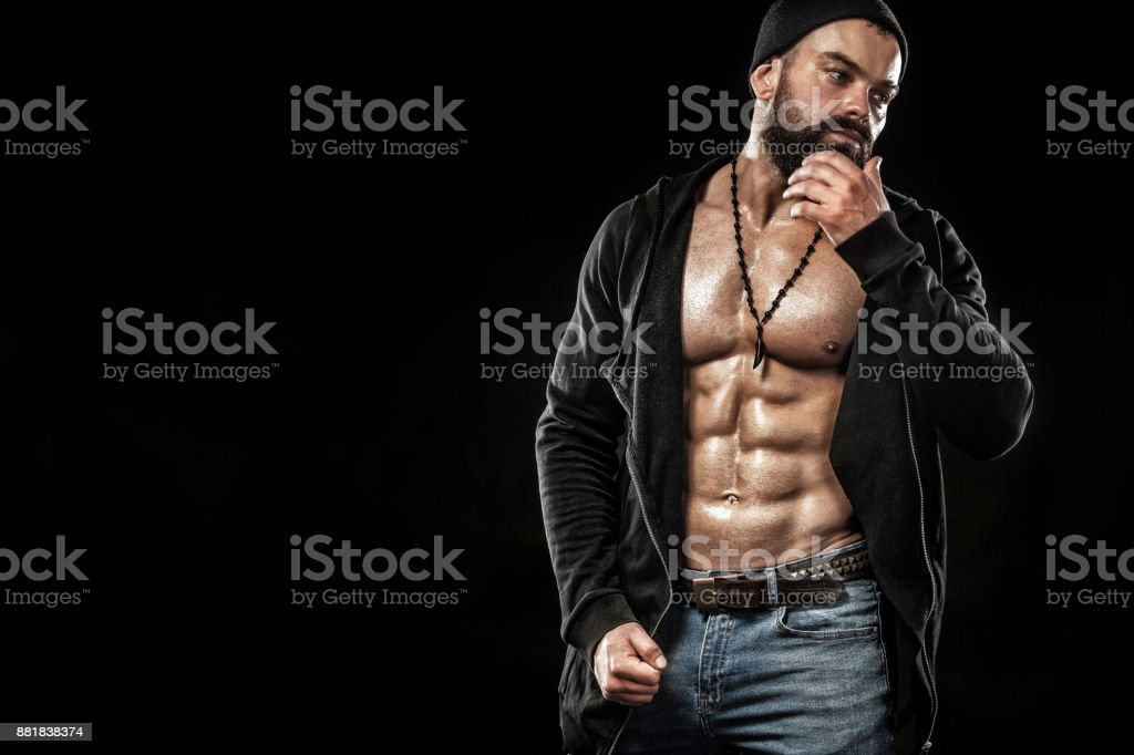 Bodybuilder posing. Beautiful sporty guy male power. Fitness muscled man. Spot concept with copy space stock photo