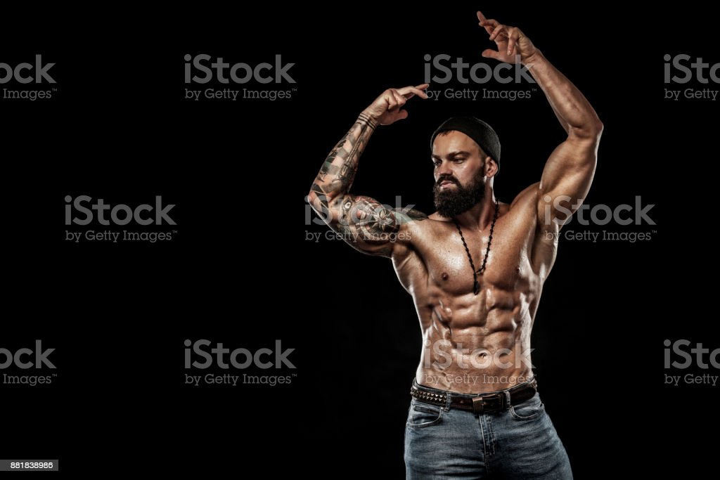 Bodybuilder posing. Beautiful sporty guy male power. Fitness muscled man. Spot concept stock photo