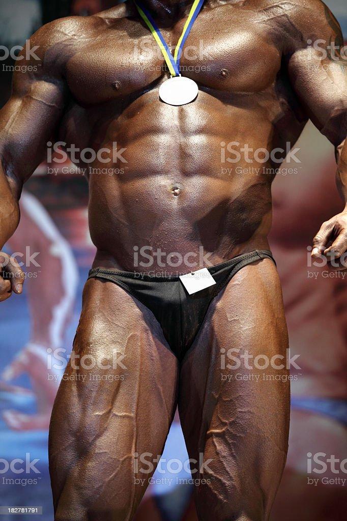Bodybuilder posing royalty-free stock photo