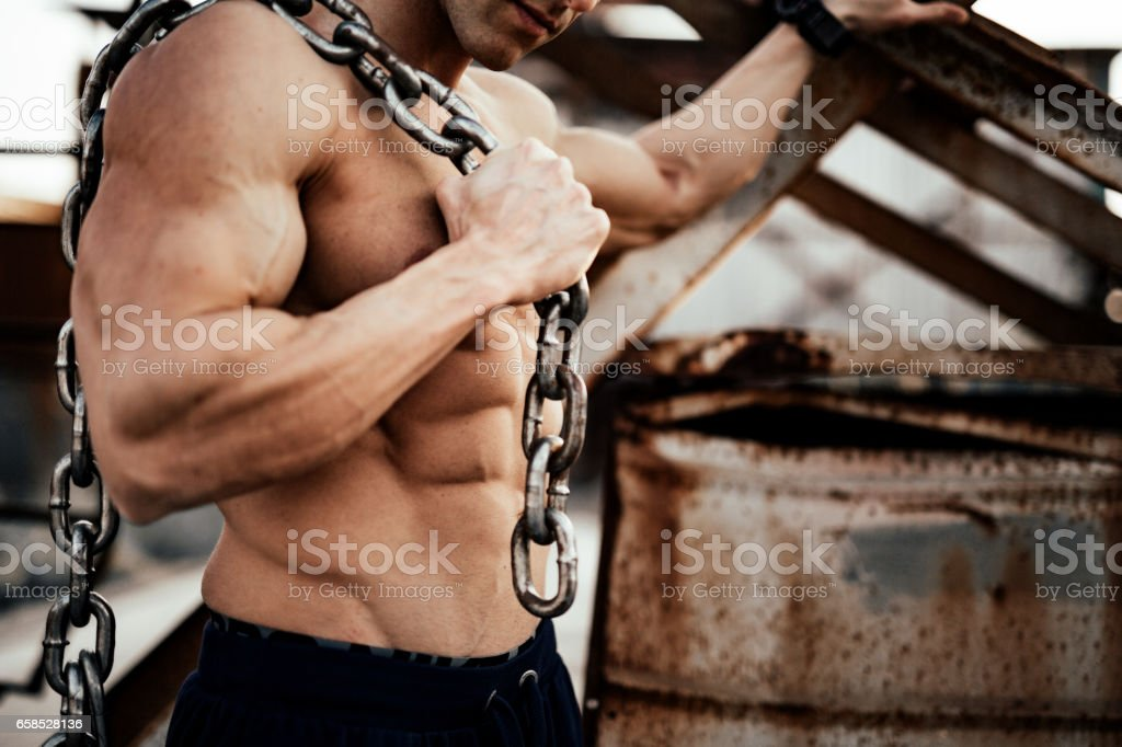 Bodybuilder posing stock photo