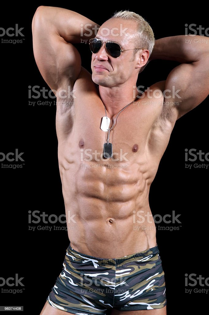 Bodybuilder posing royalty-free stock photo
