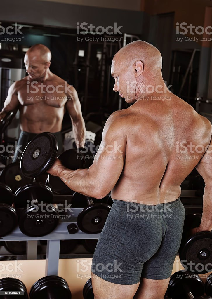 bodybuilder showing his muscles royalty-free stock photo