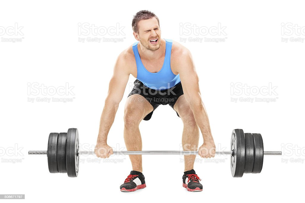 Bodybuilder struggling to lift a barbell stock photo