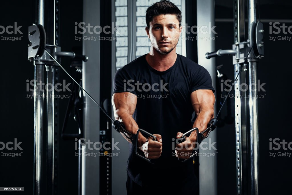Bodybuilder Training In The Gym Crossover stock photo