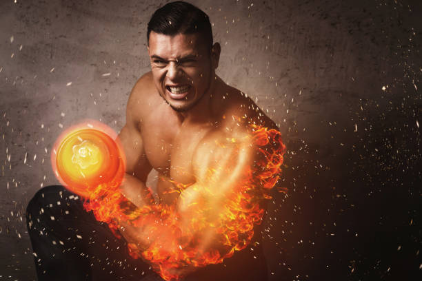 Bodybuilder with burning arm during bicep exercise with the dumbbell stock photo