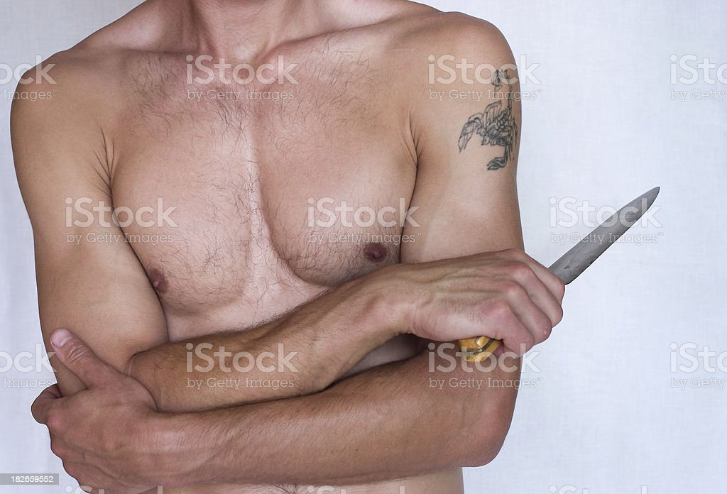 Bodybuilder with knife stock photo