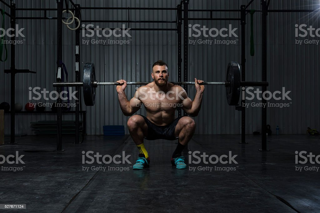Bodybuilder working out at the gym stock photo