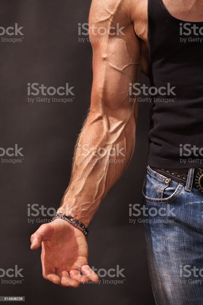Bodybuilders hand and arm with veins stock photo