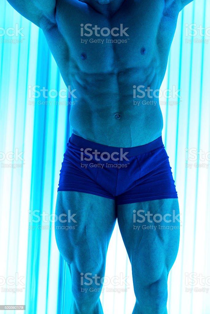 Bodybuilder In Solarium stock photo