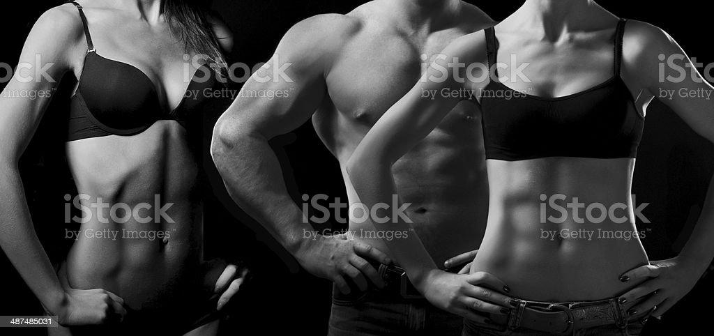 Bodybuilding. Hombre y mujer - Foto de stock de Actividad libre de derechos