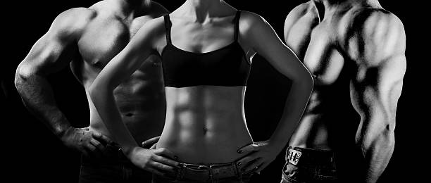 Bodybuilding. Man and woman stock photo