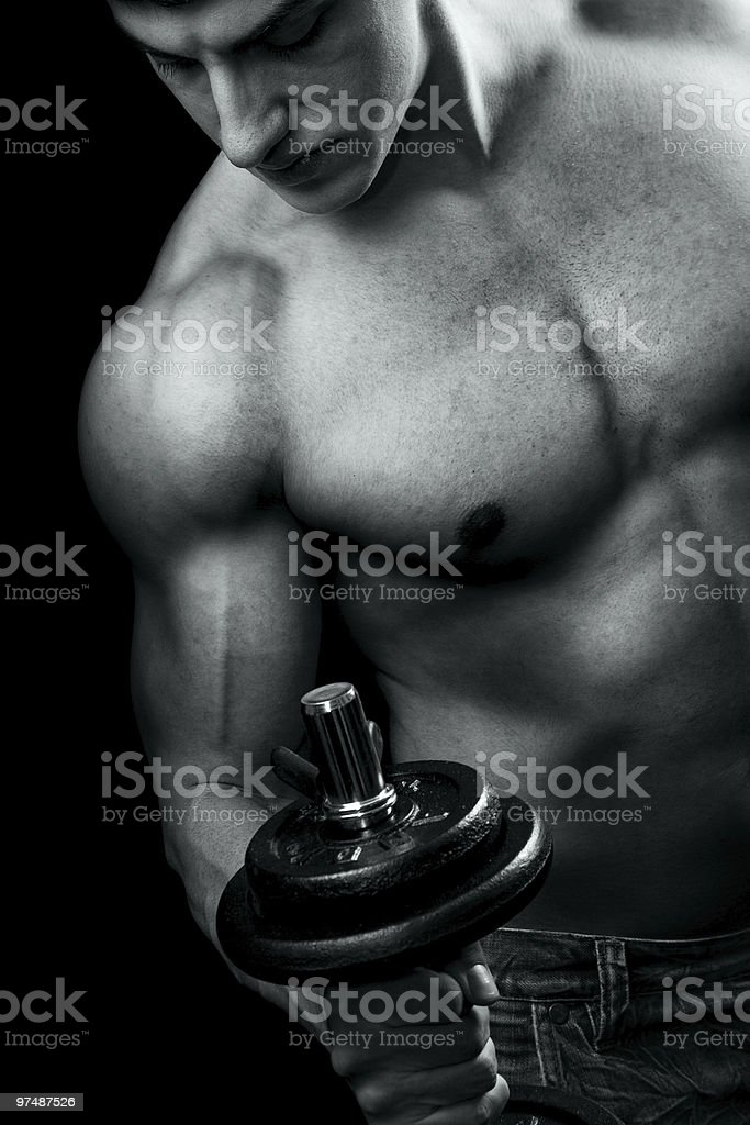 Bodybuilding - muscular man and dumbbell workout royalty-free stock photo