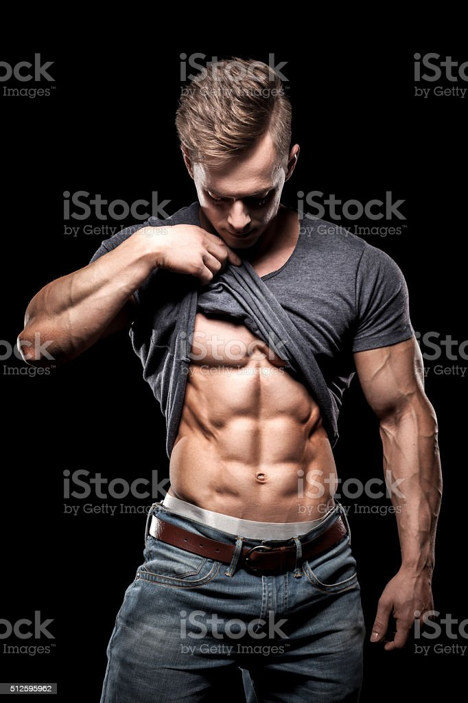 bodybuilding sportsman showing perfect abdominal abs muscles stock photo