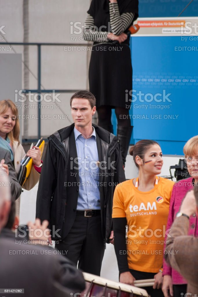 Bodyguard and electionhelpers during the visit of Merkel in stralsund stock photo
