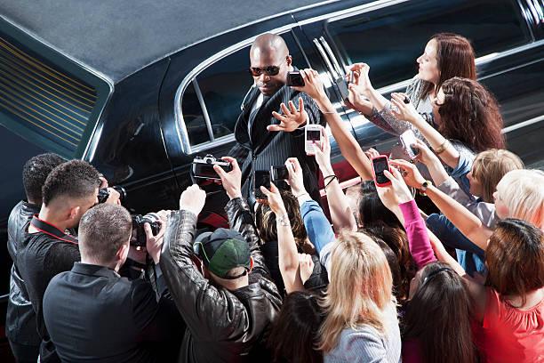 Bodyguard protecting celebrity from paparazzi picture id130406605?b=1&k=6&m=130406605&s=612x612&w=0&h=k eql2sxwnhqdm0lyio7suyc7afjekv4x3kv 9gq0xy=