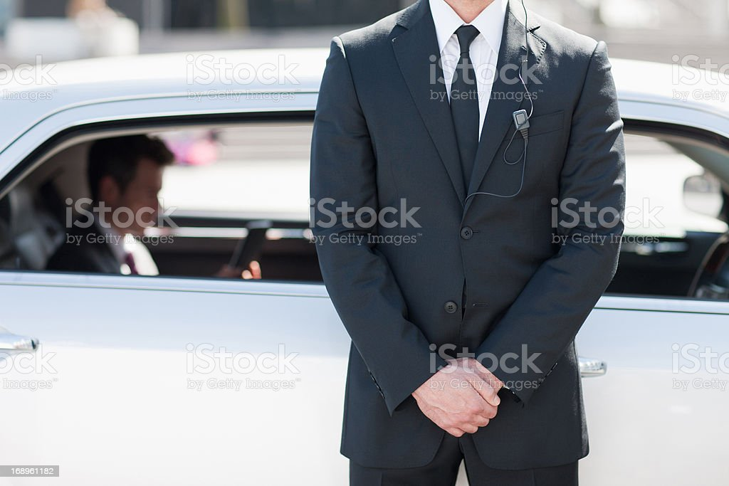Bodyguard protecting politician in backseat of car stock photo