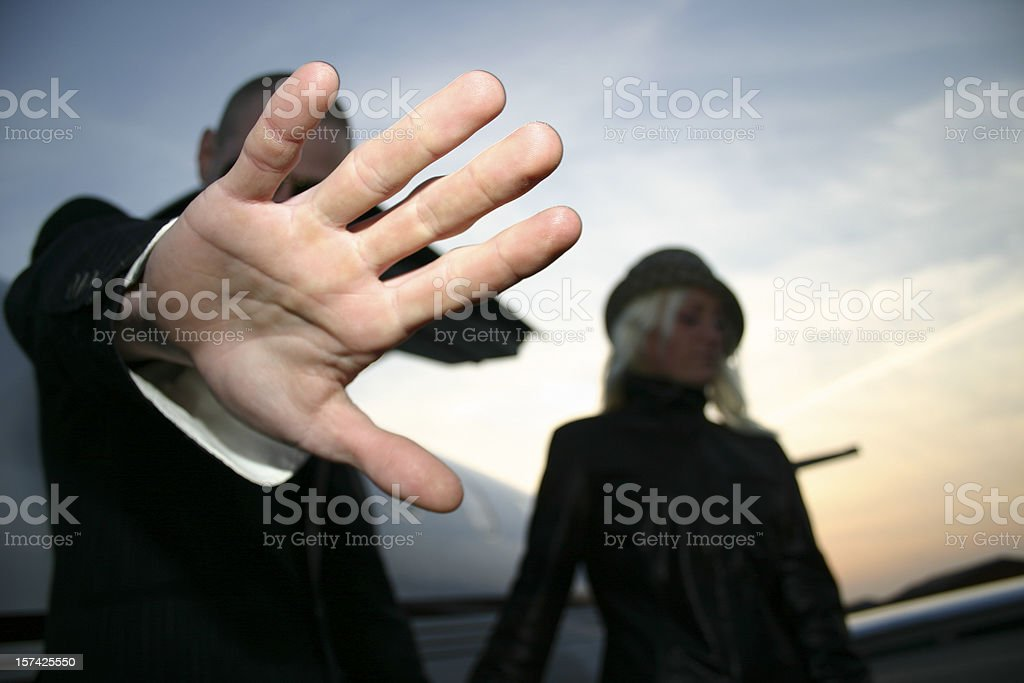 Bodyguard protecting VIP royalty-free stock photo