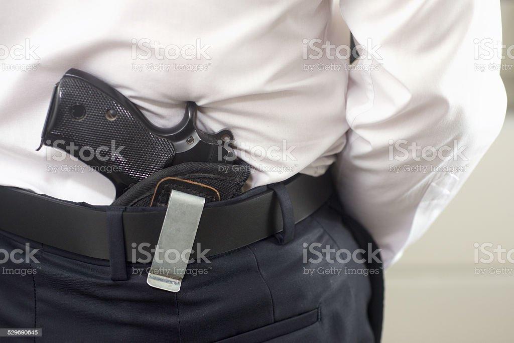 Bodyguard with gun stock photo