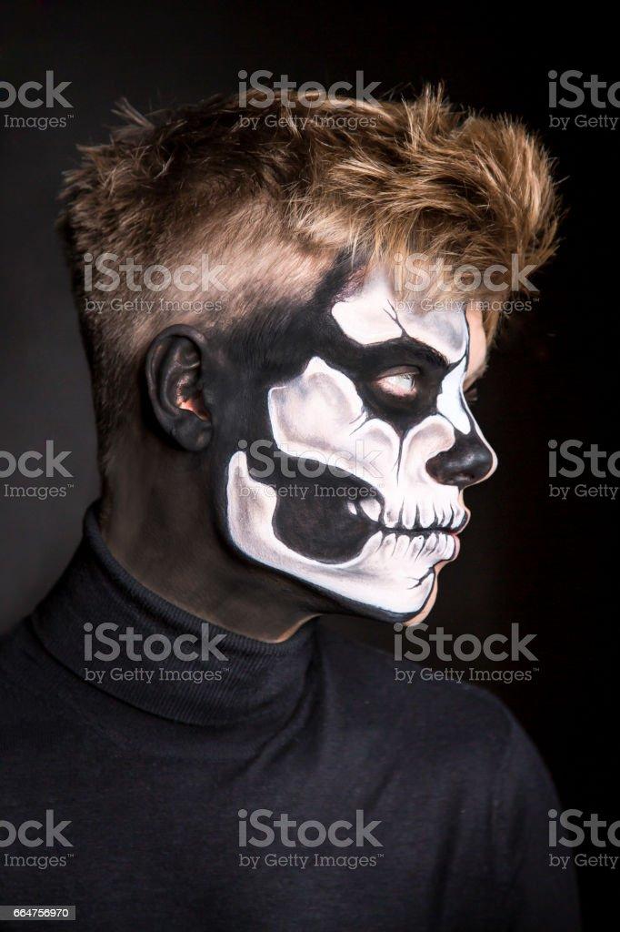 Bodypainting half skull man portrait stock photo