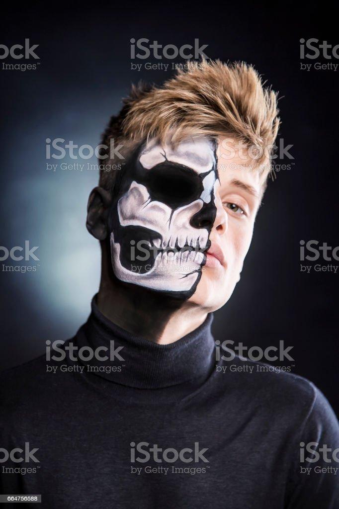 Bodypainting man portrait - skull face stock photo
