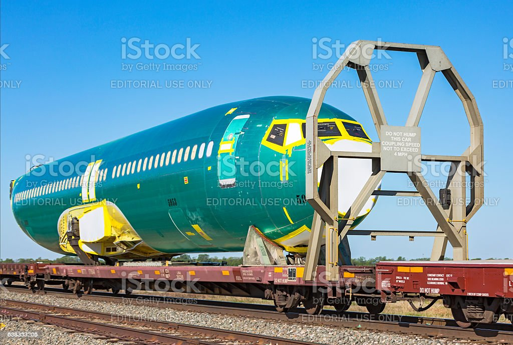 CU Boeing 737 aircraft fuselage #5953 on BNSF train stock photo