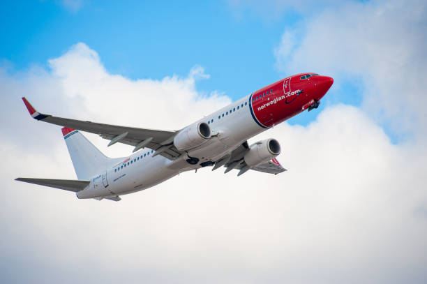 A Boeing 737 operated by Norwegian Air Shuttle departing from Helsinki-Vantaa airport. stock photo