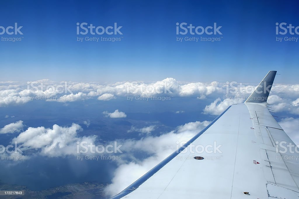 Boeing 737 Wing above the Clouds stock photo