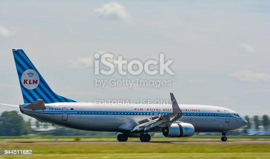 KLM Boeing 737 landing at Schiphol airport. The plane is fitted with special retro livery to celebrate 90 years of Royal Dutch Airlines.