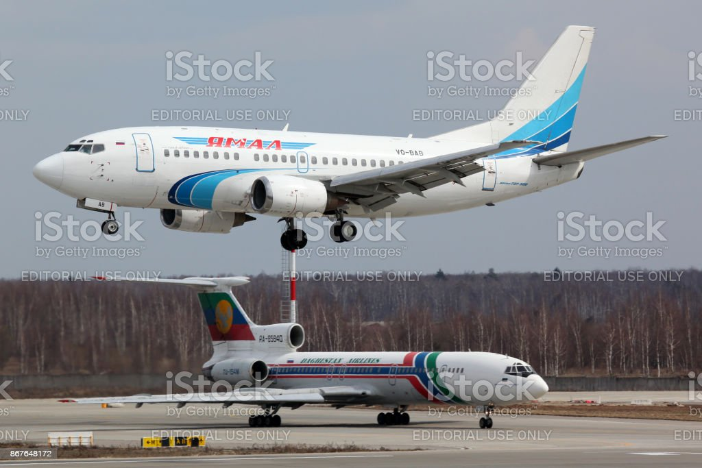 Boeing 737-56N VQ-BAB of Yamal Airlines landing at Domodedovo international airport. stock photo