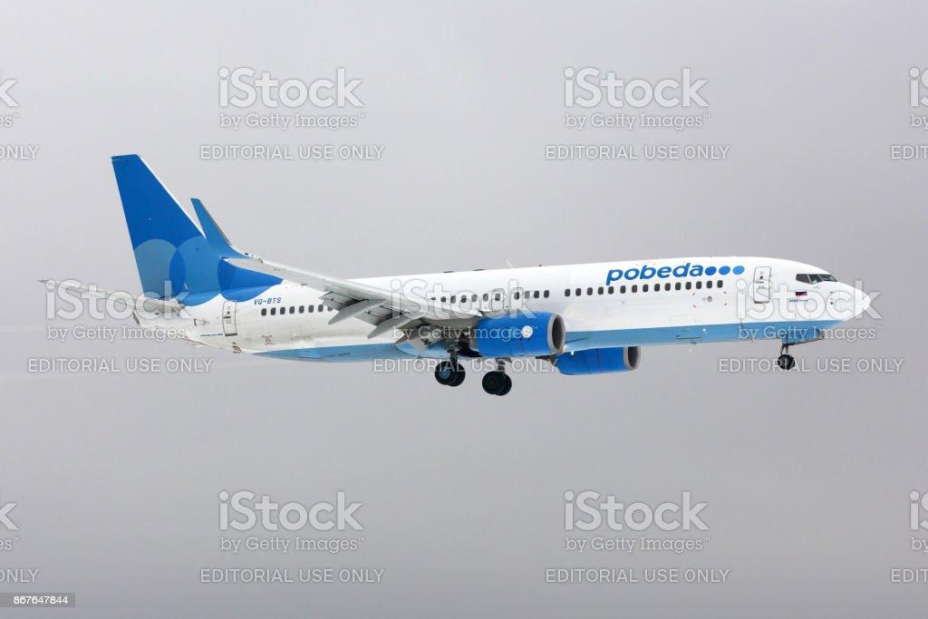 Boeing 737-800 of Pobeda airlines landing at Vnukovo international airport. stock photo