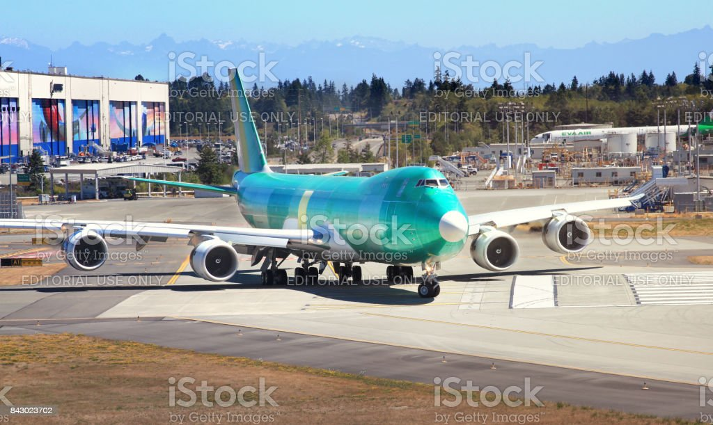 Boeing 747 aircraft taxing on the runway stock photo