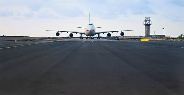 Boeing 747 on runway in Hawaii.