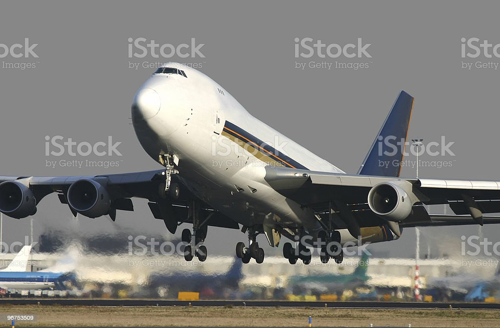 A Boeing 747 taking off on a sunny day stock photo