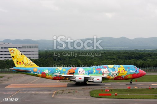 SAPPORO, JAPAN - June 15, 2009: Boeing 747-400 of All Nippon Airways (ANA) decorated with images of different Pokemons on runway before taking off in New Chitose Airport, Hokkaido, Japan