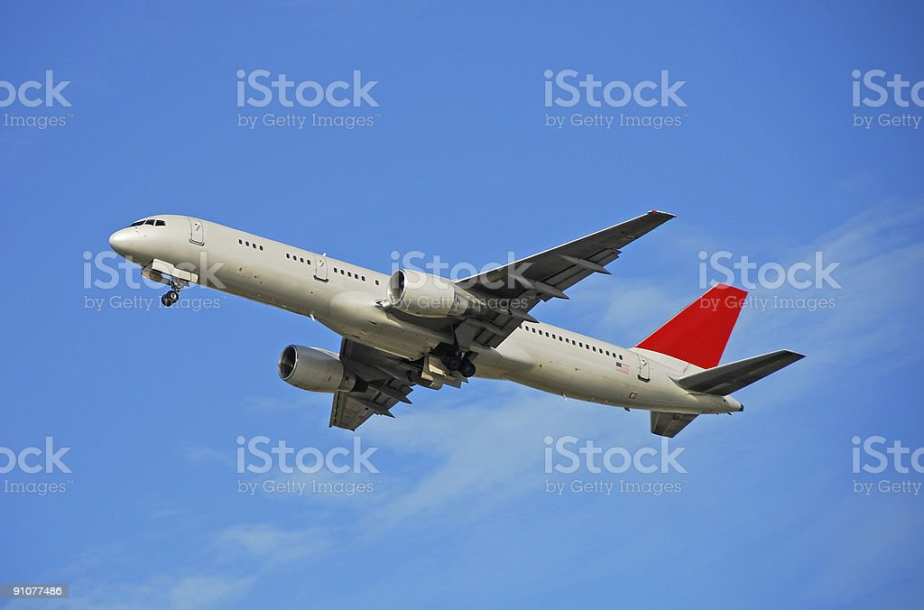 Boeing 757 passenger jet taking off stock photo