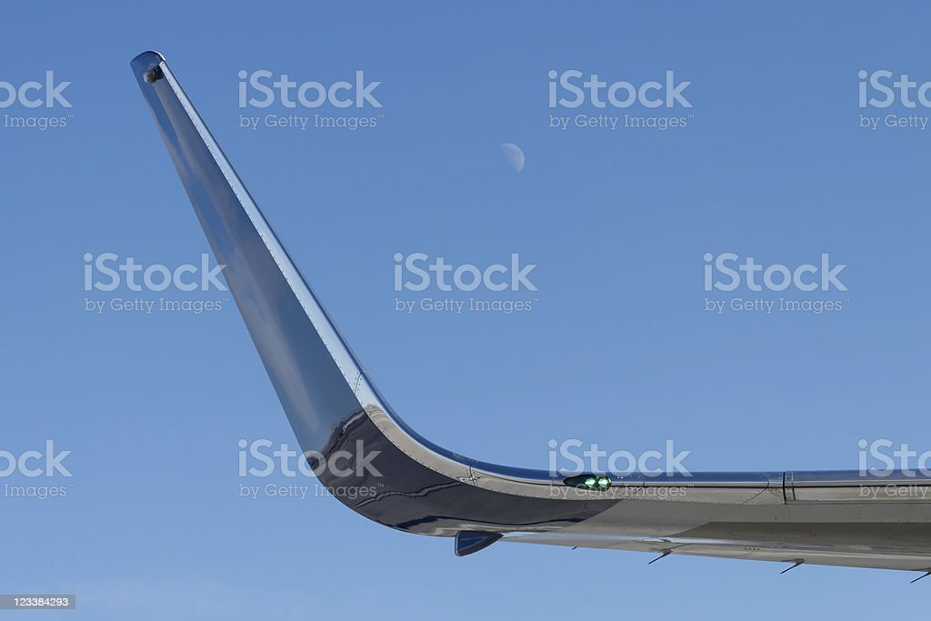 Boeing 757 winglet with moon stock photo