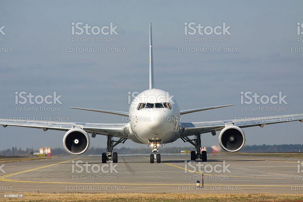 Boeing 767 on runway stock photo