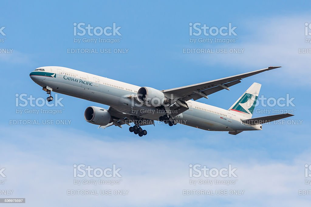 Boeing 777 Cathay Pacific takes off from JFK Airport stock photo