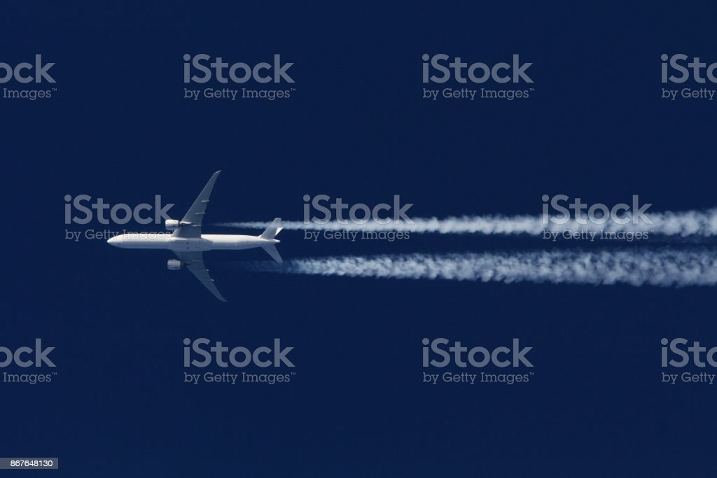 Boeing 777 civil airliner flying on high altitude stock photo