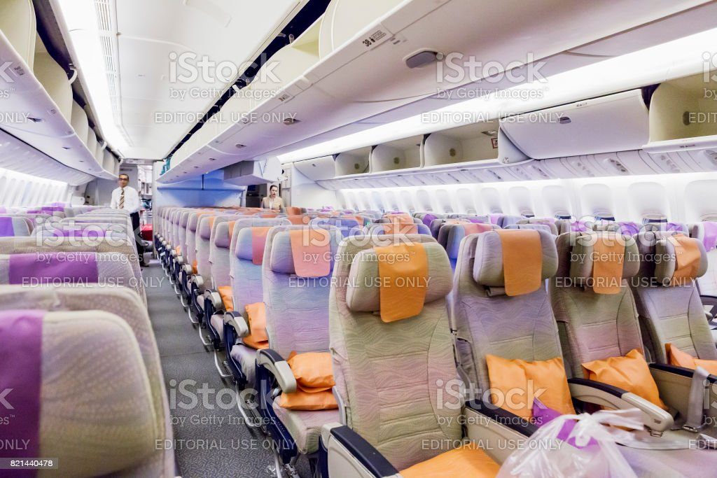 Boeing 777 EMIRATES, Interior Economy class with TV Touch screen in Emirates Airlines in Dubai Airport. stock photo
