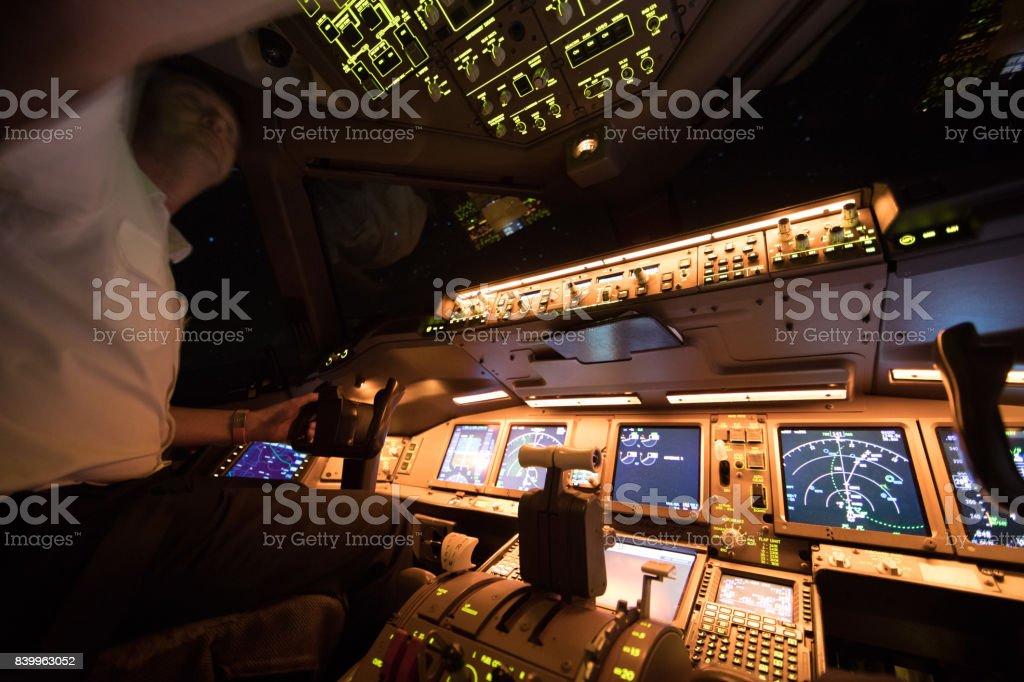 Boeing 777 Night Flight over Europe stock photo