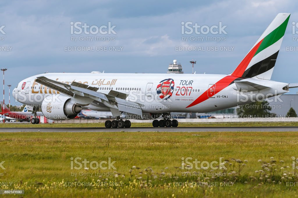 Boeing 777 of Emirates airlines is landing at airport Pulkovo stock photo