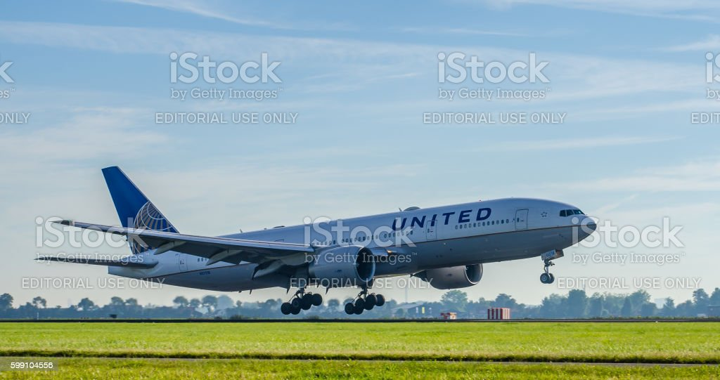Boeing 777 of United Airlines landing at Schiphol stock photo