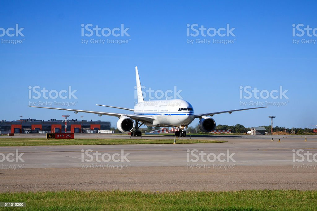 Boeing 777 taxiing in airport stock photo