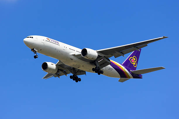 boeing 777-200er hs-tjs of thaiairway - respiratory tract stock photos and pictures