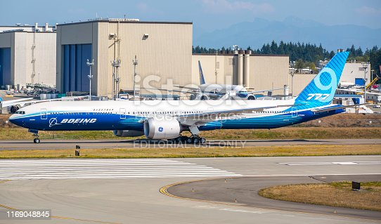 This image is of a Boeing 777x doing a high speed taxi test at Seattle Everett airport. The Boeing 777X is the latest series of the long-range, wide-body, twin-engine Boeing 777 family from Boeing Commercial Airplanes. The 777X will feature new GE9X engines, new composite wings with folding wingtips, greater cabin width and seating capacity, and technologies from the Boeing 787. The 777X was launched in November 2013 with two variants: the 777-8 and the 777-9. The 777-8 provides seating for 365 passengers and has a range of 8,690 nmi (16,090 km) while the 777-9 has seating for 414 passengers and a range of over 7,525 nmi (13,936 km). The -9 is expected to fly in 2020 with deliveries the same year.