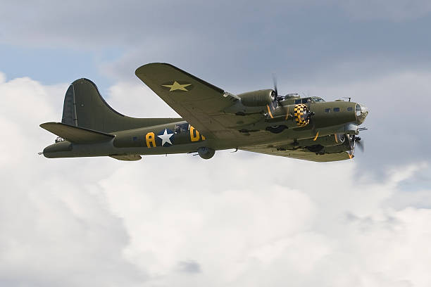 """Boeing B-17G Flying Fortress Boeing B-17G Flying Fortress """"Sally B"""" displays at Duxford Flying Legends Air Display. bomber plane stock pictures, royalty-free photos & images"""